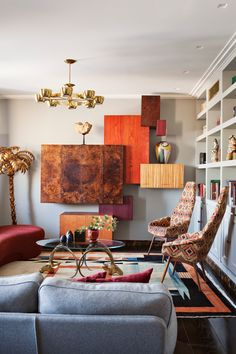Apartment of Sergei Semak in Moscow..  Great wall installations and mid century patterned chairs.