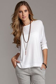 rolled sleeve loose white tee- matches everything and can be dressed up or down