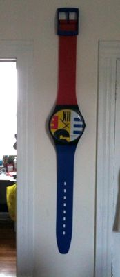 Had a yellow Swatch Watch Clock. Loooved it! Thanks mom 'n dad.  ;0)
