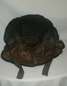 Civil War 1860's Vintage Black Silk Quilted Hood Bonnet | eBay Hand stitched 1860's Civil War era quilted black silk hood bonnet.  Bonnet has a 7 inch shoulder curtain.  Back neck area trimmed wt black silk bow.  Bonnet has black silk chin ties and lined wt cotton.