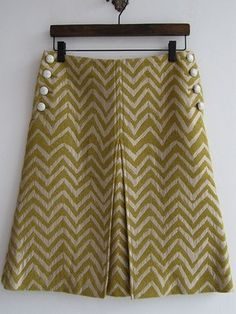 so many cute skirts on this site - olive green a-line skirt with chevron pattern and kick pleat