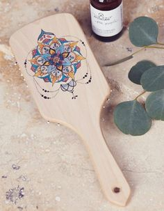 Brush your boho hair with this hand-painted wooden brush.