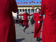 March 2014 Chinese hostesses, who serve the delegates of the Chinese People's Political Consultative Conference and National People's Congress, have souvenir photos taken in front of the Great Hall of the People during sessions of the CPPCC and NPC held in Beijing, China AP Photo/Andy Wong