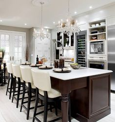 I love these counter height stools for new kitchen area- reulpolstered in green fabric. Comfy bar stools AND black & white. by Nikki W Home Design, Küchen Design, Design Ideas, Design Inspiration, Elegant Kitchens, Beautiful Kitchens, Modern Kitchens, Kitchen Modern, Luxury Kitchens