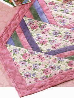 Free Spring Flower Runner Quilt Pattern -- Download this free table runner quilting pattern from http://FreePatterns.com.