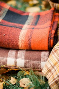 plaid wool blankets - to keep out on the porch, for cuddling by the outdoor fireplace and enjoying a cup of tea or wine ; )