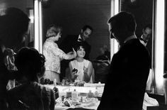 Not originally published in LIFE. Natalie Wood beams as assistants help her get glam for the Academy Awards on April 9, 1962.