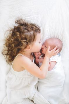 A kiss from big sister. Please take one of these of Clare and Lyndon!