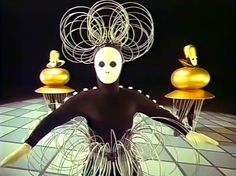 """""""Triadisches Ballett (Triadic Ballet) is a ballet developed by Oskar Schlemmer. It premiered in Stuttgart, on 30 September 1922, with music composed by Paul Hindemith and with the performers Elsa Hotzel and Albert Burger. The ballet became the most widely performed avant-garde artistic dance and while Schlemmer was at the Bauhaus from 1921 to 1929, the ballet toured, helping to spread the ethos of the Bauhaus""""- Wikipedia Link"""