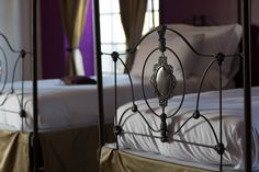 Four Poster bed in Purple bed room at chateau Robert in France www.chateaurobertfrance.fr