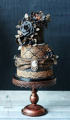 A Gorgeous Victorian inspired cake with lace and fine details.15 Stunning Black Wedding Cakes   Postris