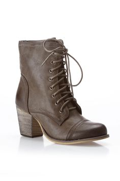 I like the heel.  It makes em easier to pull off.  The flat lace ups make me look like im tryin a lil too hard haha