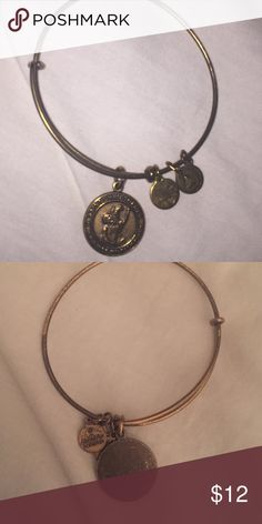 Saint Christopher Alex and Ani Saint Christopher Alex and Ani . Has been worn and some tarnishing as displayed in pics Alex & Ani Jewelry Bracelets