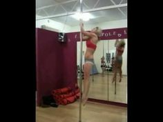Pole Spin climb into aerial invert and controlled exit out