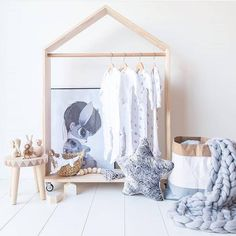 How about an adorable mini house wardrobe? It would make such a charming addition to any baby nursery http://petitandsmall.com/diy-clothes-hangers-babies/