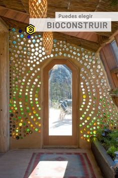 Cool bottle wall in an Airbnb earthship - Grand Designs Earthship Te Timatanga - Earth houses for Rent in Hikuai Maison Earthship, Earth Bag Homes, Colored Glass Bottles, Coloured Glass, Natural Building, Rustic, Diy And Crafts, Decor Crafts, Bottle House