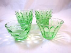 Vintage 8 Green Sherbet Bowls Glass Antique Green Glass Bowls Hazel Atlas Panel Pattern Bowls 1920s Small individual serving bowls for Nuts, candy, sherbet, or finger bowls Depression era Green Uranium glass 7 are Hazel Atlas Panel Pattern Embossed w/ H over A on bottom Cups are