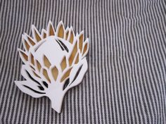 Wood and white perspex  two tone protea brooch by NetnKameel
