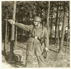 A Luftwaffe airman practices with his P.08 Luger. Note the correct holster and harness straps.