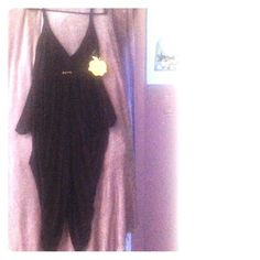 *NEVER WORN* parachute style jumpsuit Black Parachute style jumpsuit/catsuit. 98% rayon 2% spandex.  Spaghetti straps. Pockets. Tie back detail. SEE OTHER PHOTO TO SEE THIS ITEM WORN. Please don't ask to see it on me that is what the other photo is for. Thanks. Apple Bottoms Other