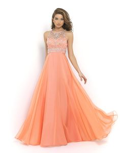Classic Blush Prom style that is romantic and flattering! This gorgeous gown features a sheer mesh bodice and jewel neckline that dips into a modern razor back embellished with clear stones and sequins. The modified A-line skirt is crafted of flowing chiffon layers that beautifully fall to the floor Blush Prom