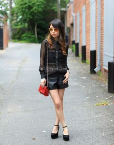 Black sheer top and leather shorts