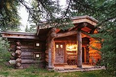 Cutest rustic tiny cabin with a large front porch! The porch has stone flooring! Who wants one?