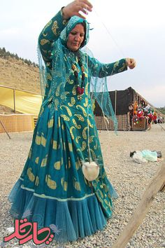 Qashqai tribal woman using her hand-spindle, Iran
