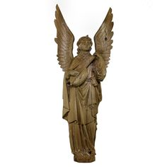 A Large Carved Statue Of The Archangel Raphael