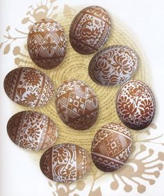 """""""Iryna Vakh also uses acid etching to create """"travlenky"""" like those on the page below. This is not a traditional Ukrainian technique, at least not when it is employed on brown eggs. Traditional pysankary would use acid etching to create white pysanky (etching as a final step to have a white background instead of a dark one). This has become quite popular in recent years in Ukraine, though, and Iryna produces lovely eggs of this variety."""""""