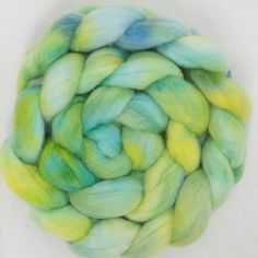 Sap, hand dyed onto Polwarth top, super fibre to spin or felt. Soft and bouncy.