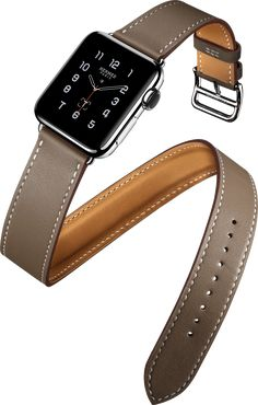 The extra-long band of the iconic Double Tour wraps elegantly twice around the wrist. Available in Fauve Barenia leatherpaired with a 38 mm stainless steel case. Each Apple Watch Hermès will come with the exclusive Hermes Sport orange strap. Hermes Apple Watch, Gold Apple Watch, Apple Watch Bands, Apple Watch Series 2, Apple Products, New Iphone, Smart Watch, Watches, Leather