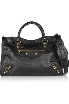 Black textured-leather (Lamb) Zip fastening along top Weighs approximately 0.9lbs/ 0.4kg