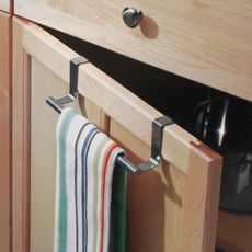 """Forma Over-the-Cabinet Towel Bar      Over-the-cabinet towel bar is not only handy but also very attractive in 18/8 brushed stainless steel. An easy way to keep towels organized. Hooks are rubber-lined to protect cabinets. Towel bar measures 2 3/4"""" H x 9 1/4"""" W x 2 3/4"""" D."""