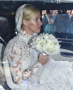 Childhood dream: Nicky, who wore her blond hair pulled back to showcase her dramatic veil, said she wanted Valentino to design her wedding dress ever since she was a little girl