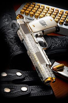 1911 Colt in silver/gold accents. <3.