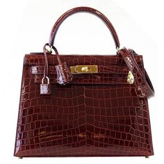 Timeless Perfection. Rare and exquisite 28 HERMES KELLY in magnificent jewel toned Bourgogne Crocodile. Rich with Gold Hardware. Divine size for day to evening. Simply insanely beautiful! NEW or NEVER