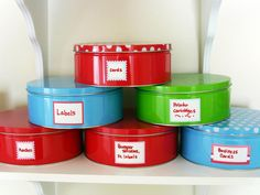 Cookie Tin Storage  Do you have leftover cookie tins from the holidays? Use them to store large office items, such as ink cartridges for the printer. Stack the tins to save counter space.