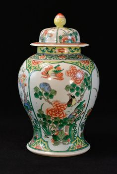 "Chinese Famille Verte Porcelain Covered Jar bird and floral motif, good condition except small edge chips on the cover edge, 19th cen, measures 9"" w, 17"" h"