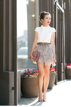 Shop this look on Lookastic:  http://lookastic.com/women/looks/crew-neck-t-shirt-crossbody-bag-pumps-belt-mini-skirt/8229  — White Crew-neck T-shirt  — Pink Leather Crossbody Bag  — Beige Leather Pumps  — Gold Belt  — Beige Fluffy Mini Skirt