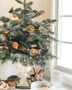 @curiouscountry posted to Instagram: Look at this adorable and simple dried orange slice garland on this Christmas tree. We love it! Make it yourself with twine and our excellent quality Dried Orange Slices! #christmas #naturaldecor #christmasdecor #winterdecor #holidays #holidaydecor #christmas2020 #christmastree #winter #christmaseve #christmasdinner #holidaydecorating #holidaydecor #christmasdecorating #holidayhome #holidayhomedecor #december #santa #christmascountdown #christmascrafts #diy