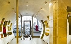 Paris store for fashion designer Stella Cadente. Almost every interior surface is covered in gold leaf <3