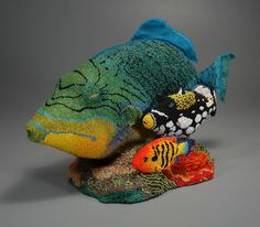 Teapot: If You Drink Any More Tea, You'll Turn Into a Fish! Design and beadwork by Leslie B. Grigsby Woodwork and assembly assistance by Lindsay Grigsby Wood, glass and wooden beads, thread H: 1...