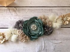 ❥Welcome to Belly Boutique Crafts!❥ ♥ Proud to be listing this beautiful sage green forest themed mixed colors maternity sash for parties like Weddings, Gender Reveal Party and Baby Shower. The sash features pearls, rhinestones, lace, fabric flowers perfect for beautifying your Baby Shower Verde, Baby Shower Sash, Baby Shower Flowers, Baby Shower Balloons, Baby Shower Favors, Baby Shower Parties, Baby Shower Themes, Fabric Flowers, Lace Fabric