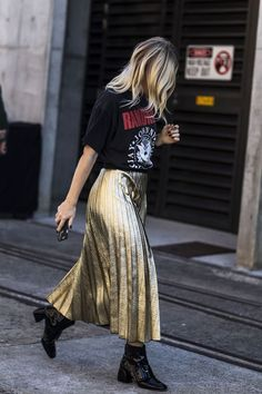 Dress down a gold pleated skirt with a simple band tee and block heel booties | Metallics