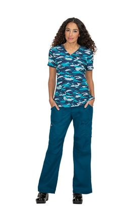 Mock-wrap top with modern fashion-forward print design. Classic mock-wrap top Two front pockets Stretch that moves with you. Koi Scrubs, Dobby, Caregiver, Modern Fashion, Fashion Forward, Polyester Spandex, Print Design, Tops, In Trend