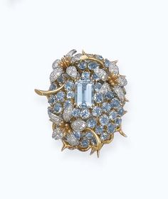 AN AQUAMARINE AND DIAMOND FLORAL BROOCH, BY JEAN SCHLUMBERGER