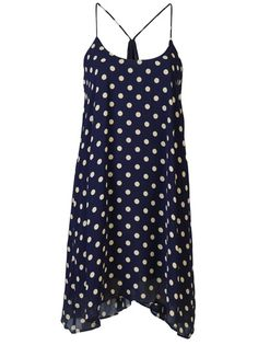 Carrie dress in ink from Backstage features spaghetti straps, a scoop neck and loose fit. Has ruched back center, polka dot design and is fully lined.