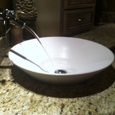 Clean and contemporary. White vessel sink. Bathroom design by Kristy Scharenbroch.