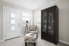 Seating area in the owner's bedroom / master suite with adjacent balcony to enjoy the outdoors Master Suite, Master Bedroom, Home Builders, China Cabinet, Balcony, New Homes, Outdoors, Street, Storage